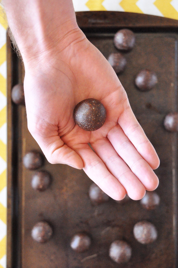 Holding a homemade Vegan Truffle made with cinnamon and cayenne