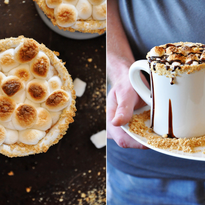 Mugs of our S'mores Hot Chocolate recipe with a toasted marshmallow and graham cracker topping