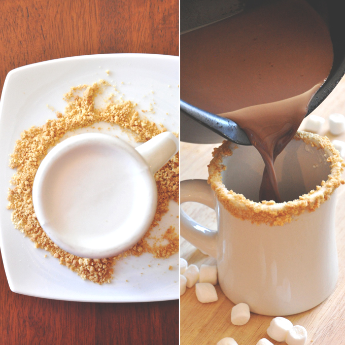 Pouring hot chocolate into a mug rim lined with graham cracker crumbs