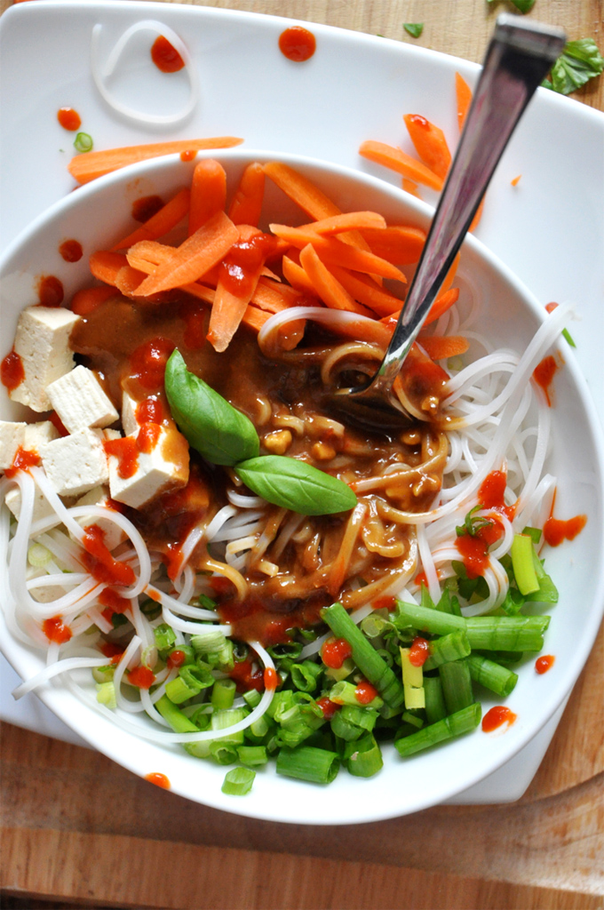 A gluten-free vegan homemade Asian Noodle Bowl topped with Ginger Peanut Dressing