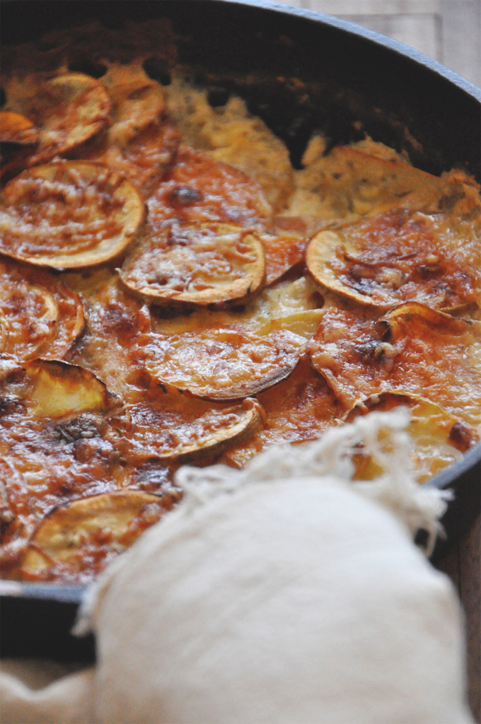 Batch of our Sweet Potato Parmesan Gratin recipe in a cast-iron skillet