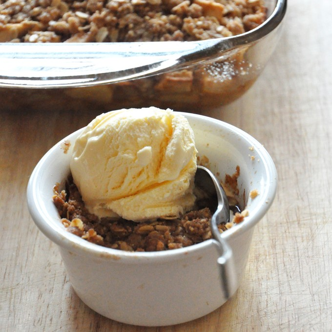 Batch of our Gluten-Free Vegan Apple Crisp recipe and a serving topped with ice cream