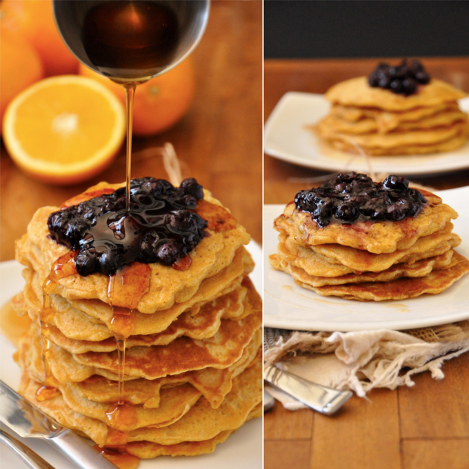 Pouring syrup onto Whole Wheat Griddle Cakes topped with Blueberry Orange Compote