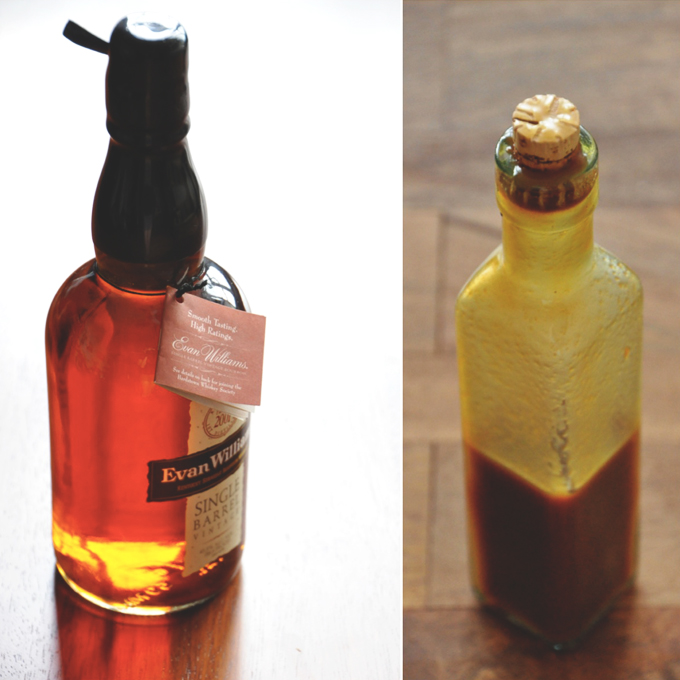 Bottle of bourbon and bottle of caramel sauce made with the bourbon