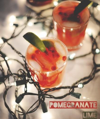 Christmas lights surrounding glasses of our Pomegranate Lime Spritzers recipe