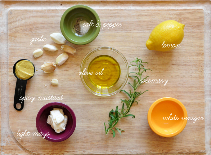 Cutting board with ingredients for making Rosemary Caesar Dressing