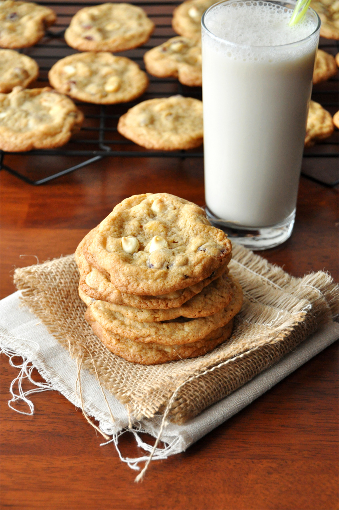 Glass of milk alongside a batch of our White Chocolate Cranberry Cookies recipe