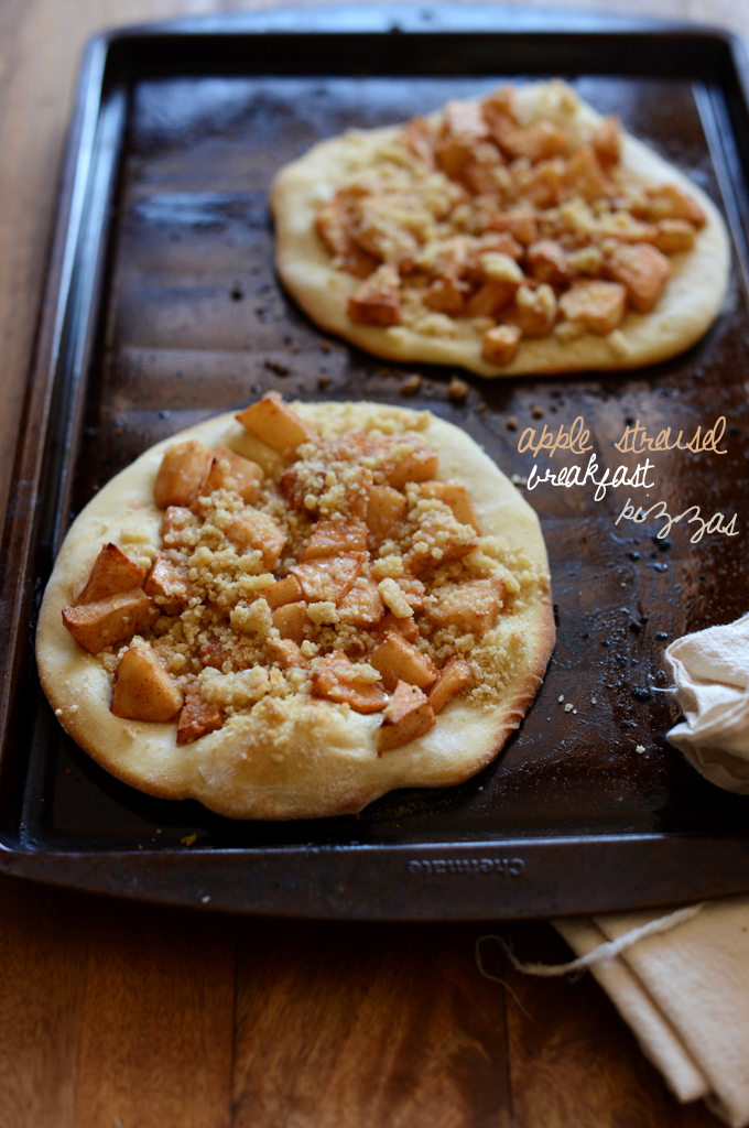 Two freshly baked Apple Streusel Breakfast Pizzas on a baking sheet