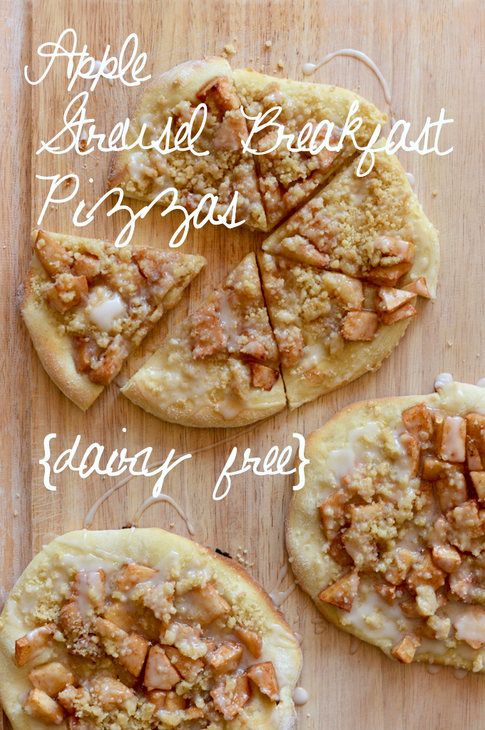 Cutting board topped with homemade dairy-free Apple Streusel Breakfast Pizzas