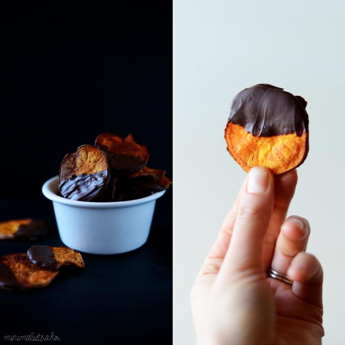 Holding up a Dark Chocolate Sweet Potato Chip alongside a bowl of more of them