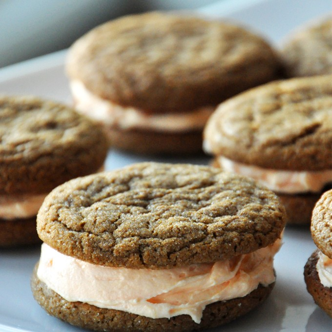 Plate of delicious Ginger Cookie Sandwiches with Orange Buttercream