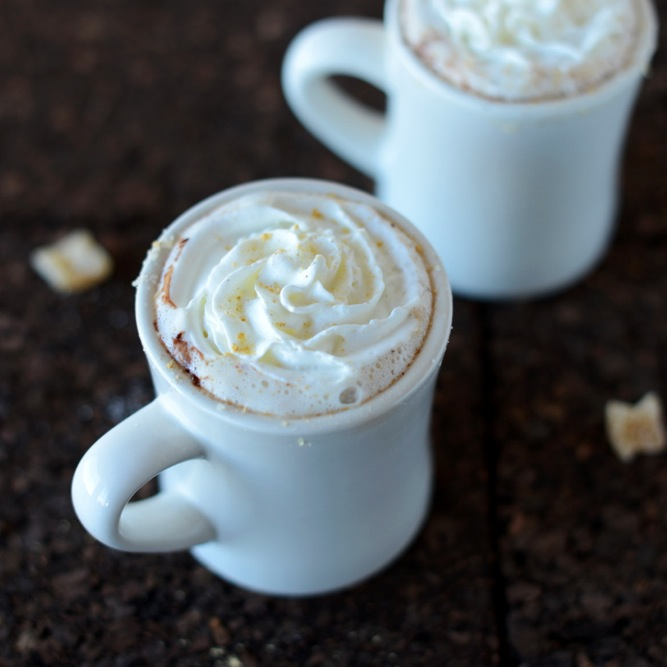 Mugs of Ginger Hot Chocolate topped with whipped cream