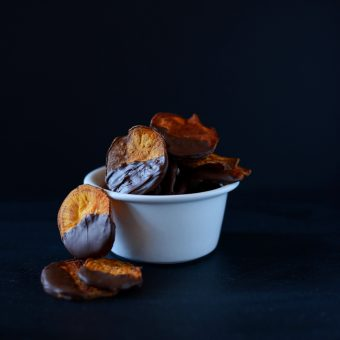 Overflowing bowl of our Dark Chocolate Baked Sweet Potato Chips recipe