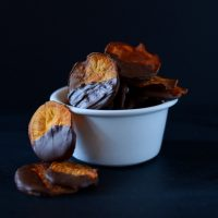Overflowing bowl of Dark Chocolate Baked Sweet Potato Chips