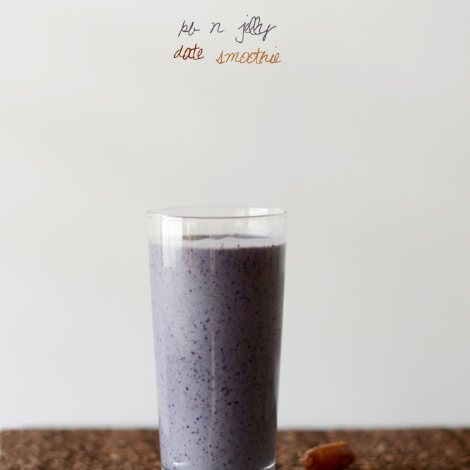 Tall glass of our Vegan Peanut Butter and Jelly Smoothie recipe for a simple breakfast