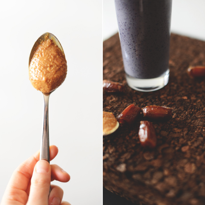 Spoonful of peanut butter and a smoothie glass surrounded by dates