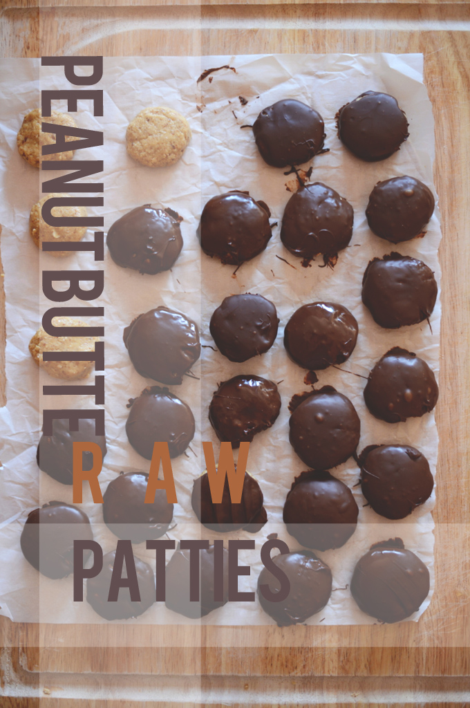 Homemade Raw Peanut Butter Patties setting up on a parchment-lined cutting board
