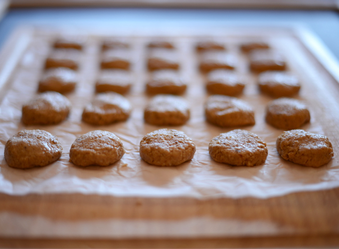 Batch of Raw Vegan Peanut Butter Cookies on a piece of parchment paper
