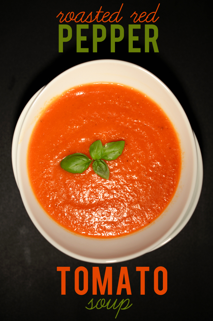 Bowl of simple homemade Roasted Red Pepper Tomato Soup topped with fresh basil