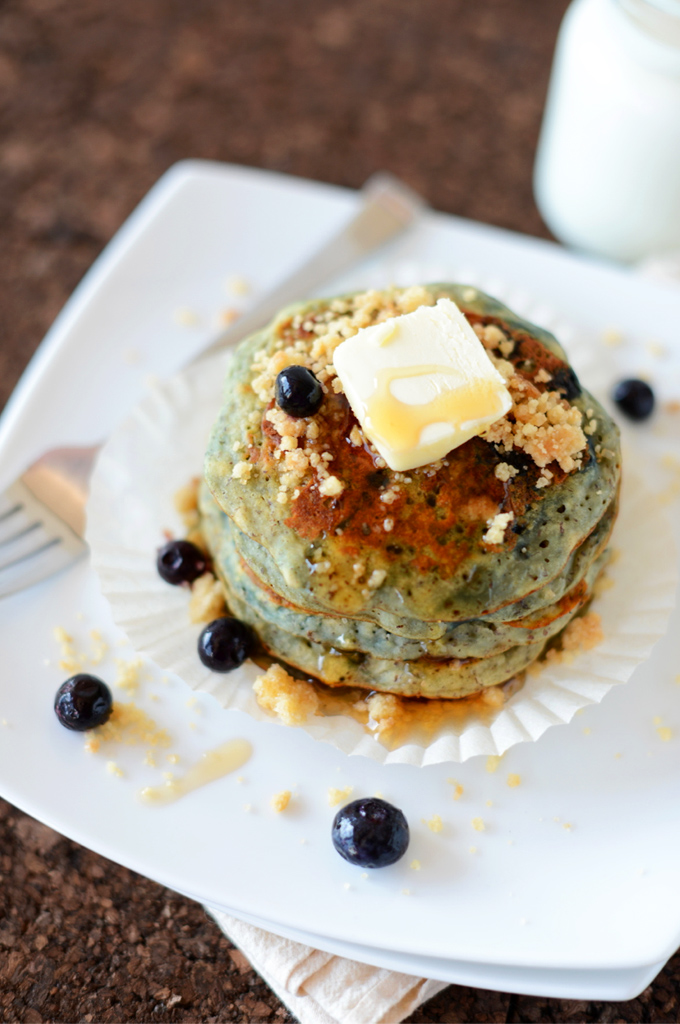 Stack of Blueberry Muffin Pancakes topped with vegan butter and streusel