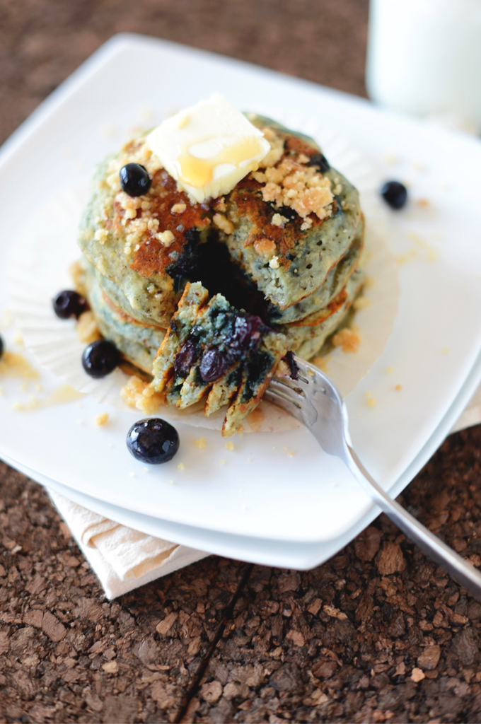 Bite of Vegan Blueberry Muffin Pancakes speared with a fork