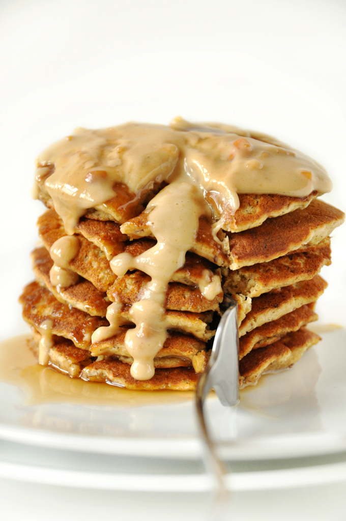 Using a fork to grab a big bite from a stack of Vegan Peanut Butter Pancakes