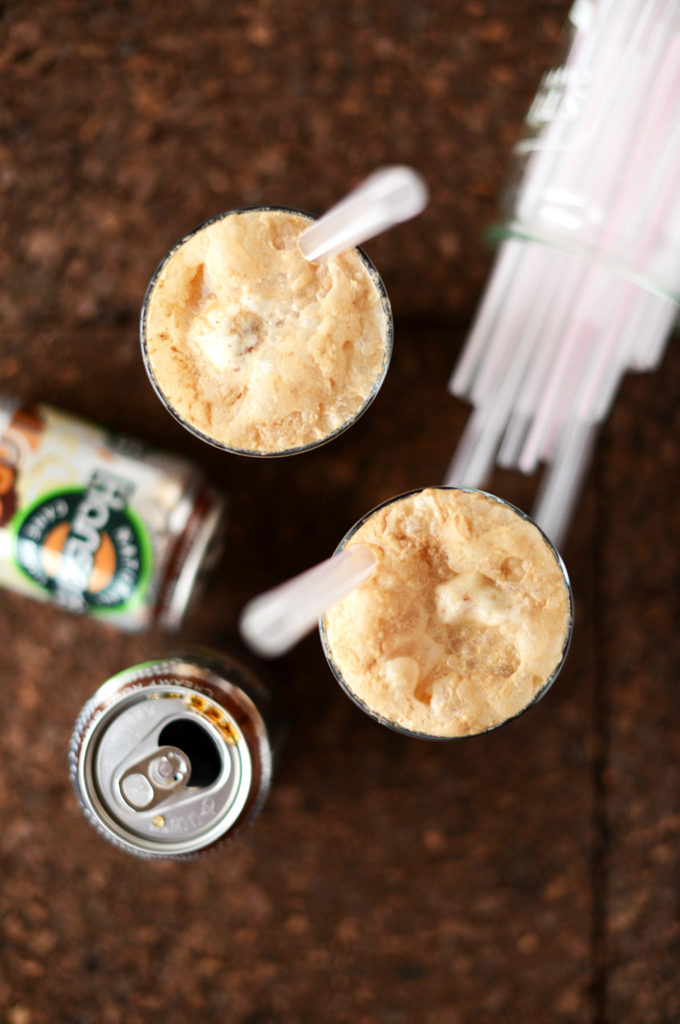 Cans of natural root beer and glasses of our delicious Vodka Root Beer Floats recipe
