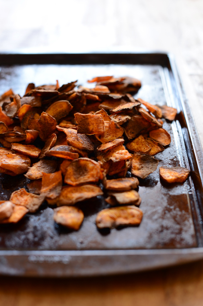 Baking sheet with a batch of freshly baked homemade Sweet Potato Chips