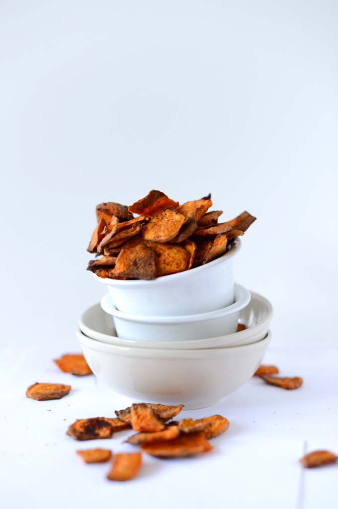Stack of bowls with the top one filled with our Chipotle Sweet Potato Chips recipe