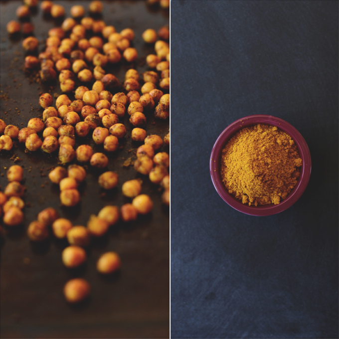 Baking sheet of crispy Chickpeas and bowl of curry powder for making them