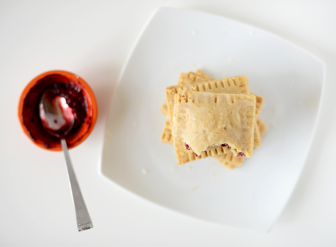 Plate of Healthy Pop Tarts and a bowl of mixed berry compote used to fill them