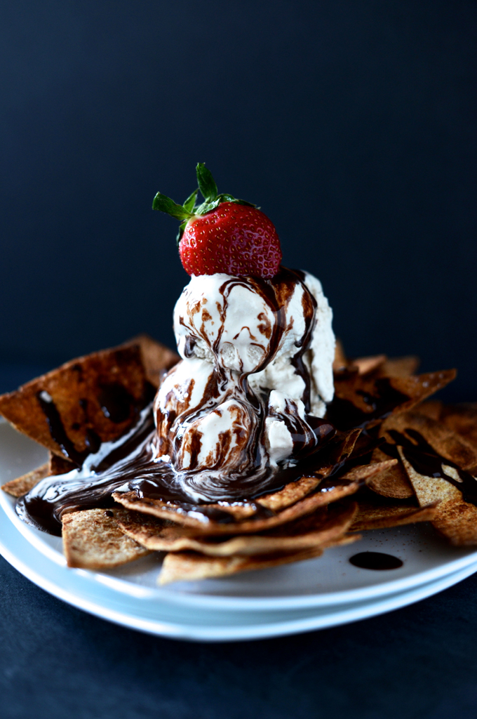 Plate of Vegan Dessert Nachos with ice cream, chocolate sauce, and a strawberry