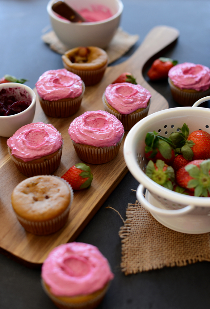 Batch of our Strawberry Beet Cupcakes recipe surrounded by ingredients used to make them