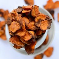 Overflowing tower of bowls filled with homemade Spicy Sweet Potato Chips