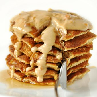 Grabbing a bite of Peanut Butter Pancakes for a delicious vegan breakfast