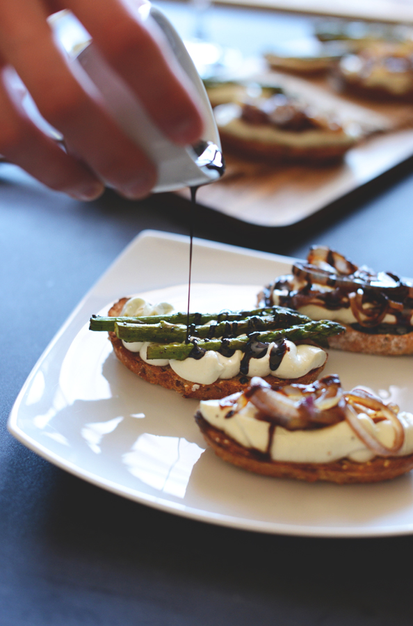 Drizzling balsamic reduction onto our Bleu Cheese Bites for a delicious vegetarian appetizer