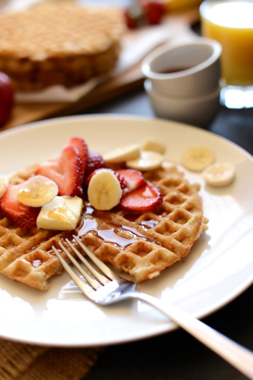 Delicious vegan breakfast of a Crispy Oatmeal Waffle with fresh fruit