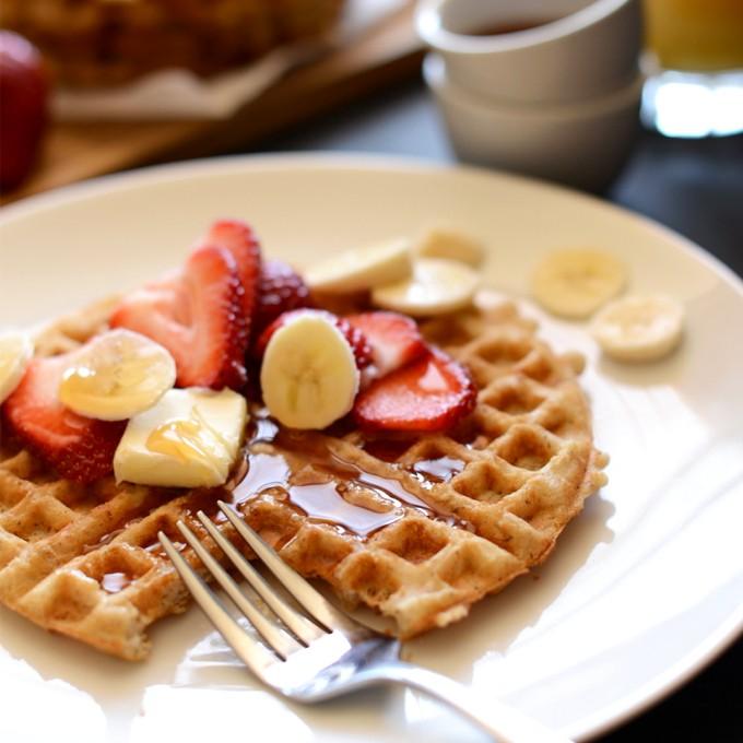 Delicious vegan breakfast of a Crispy Oatmeal Waffle with fresh fruit