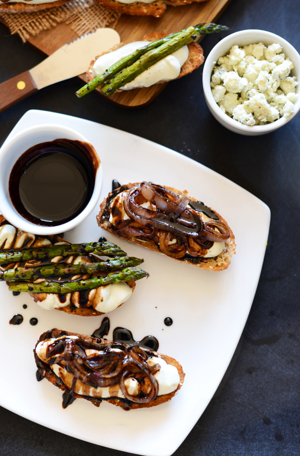 Plate of Bleu Cheese Balsamic Bites topped with caramelized onions and asparagus