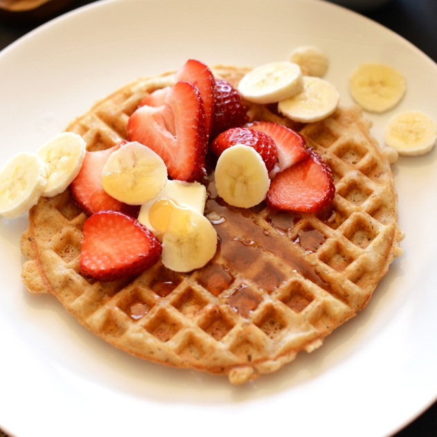 Plate with a Gluten-Free Vegan Oatmeal Waffle topped with fresh fruit and syrup