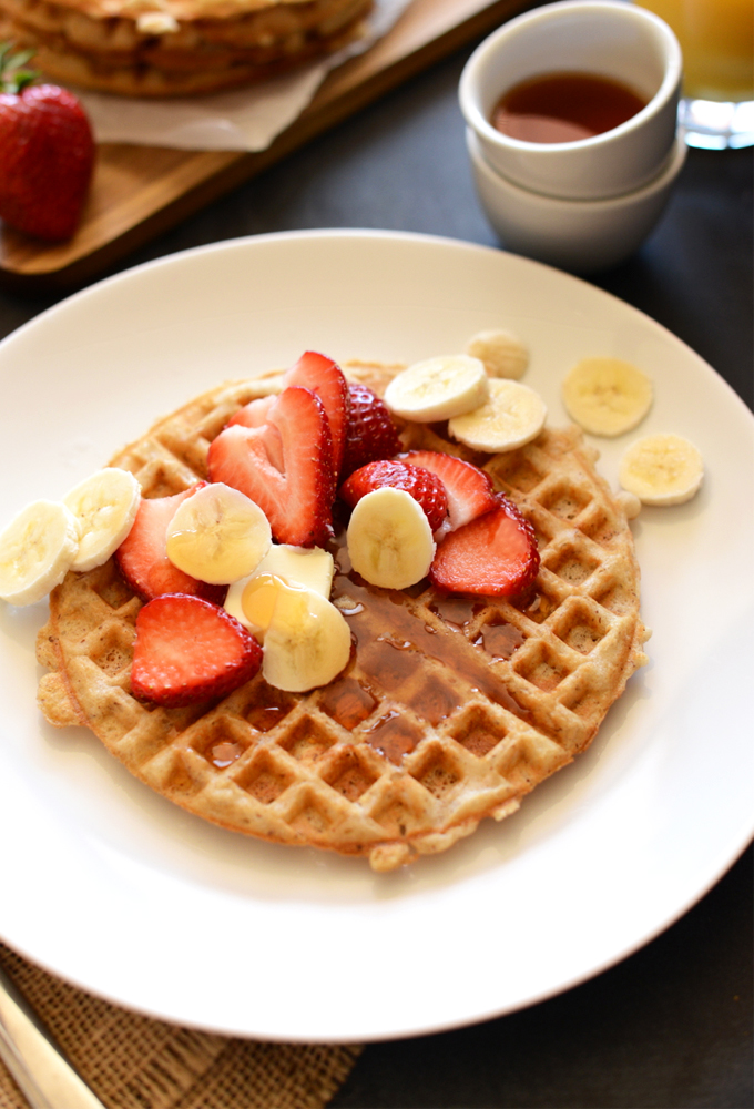 Plate with an Oatmeal Waffle topped with fresh fruit for a delicious gluten-free vegan breakfast