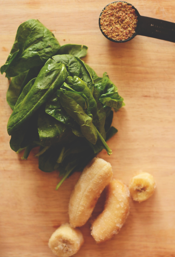 Cutting board with spinach, banana, and flax seed