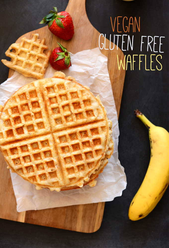 Homemade Vegan Gluten-Free Oatmeal Waffle on a cutting board alongside fresh fruit