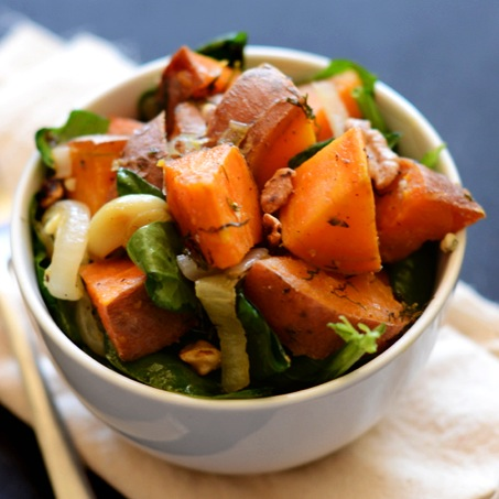 Bowl of Warm Sweet Potato Spinach Salad for a delicious vegan side dish