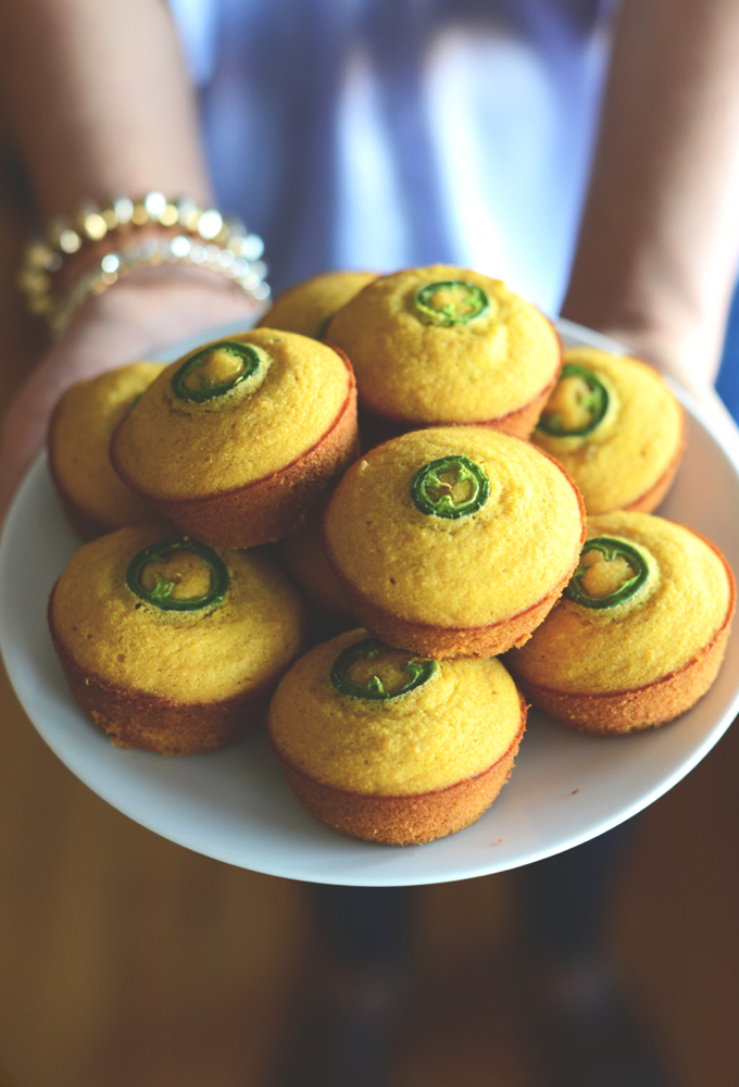 Holding a plate of our Gluten-Free Jalapeno Cornbread Muffins recipe