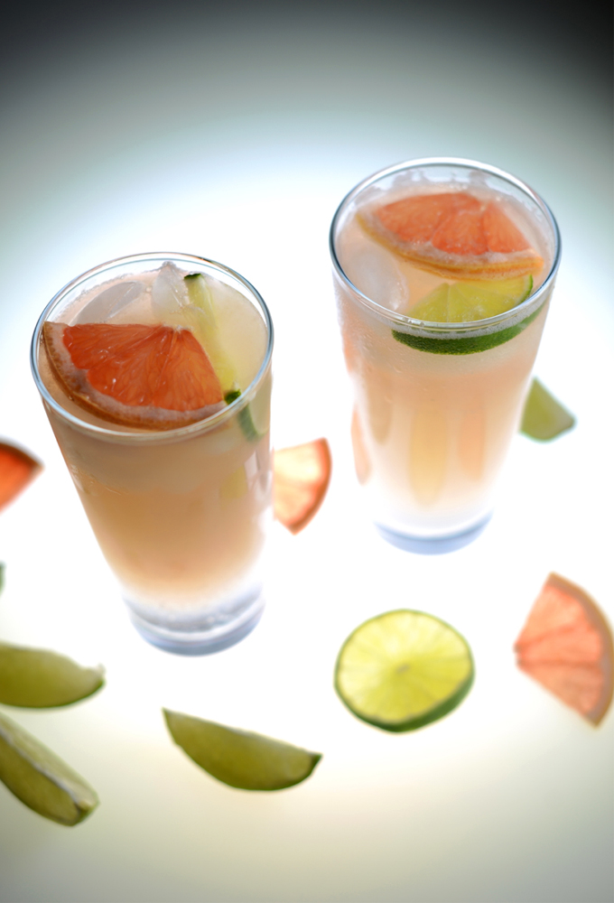 Homemade spritzers with lime and grapefruit slices in them