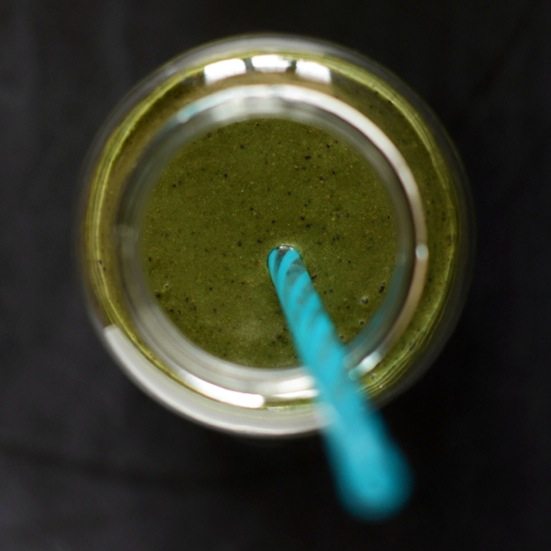 Top down shot of a straw in a jar filled with My Favorite Green Smoothie recipe