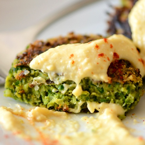 Vegan Collard Green Falafel topped with hummus and paprika