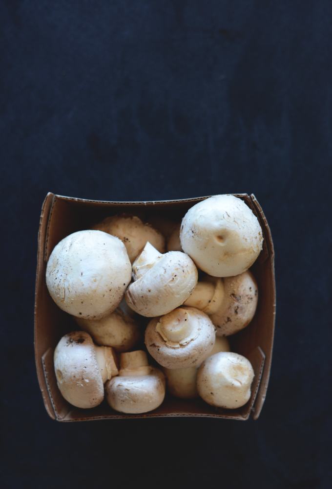 Carton of fresh button mushrooms