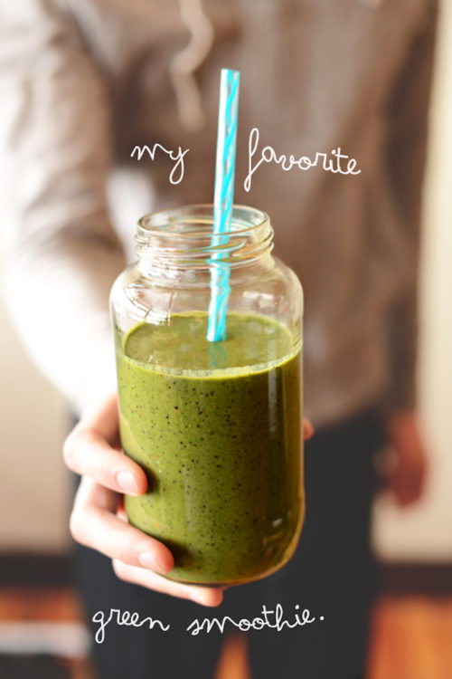 Holding a jar of our Green Smoothie recipe for a simple breakfast
